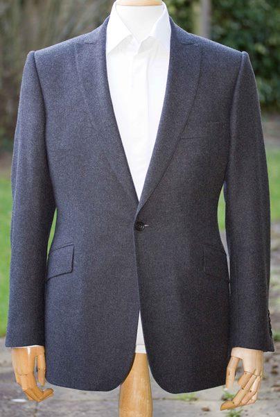 Tailored suit with peak lapel.